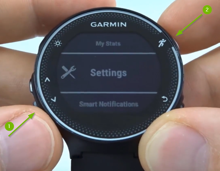 Garmin Forerunner with Settings selected on screen.