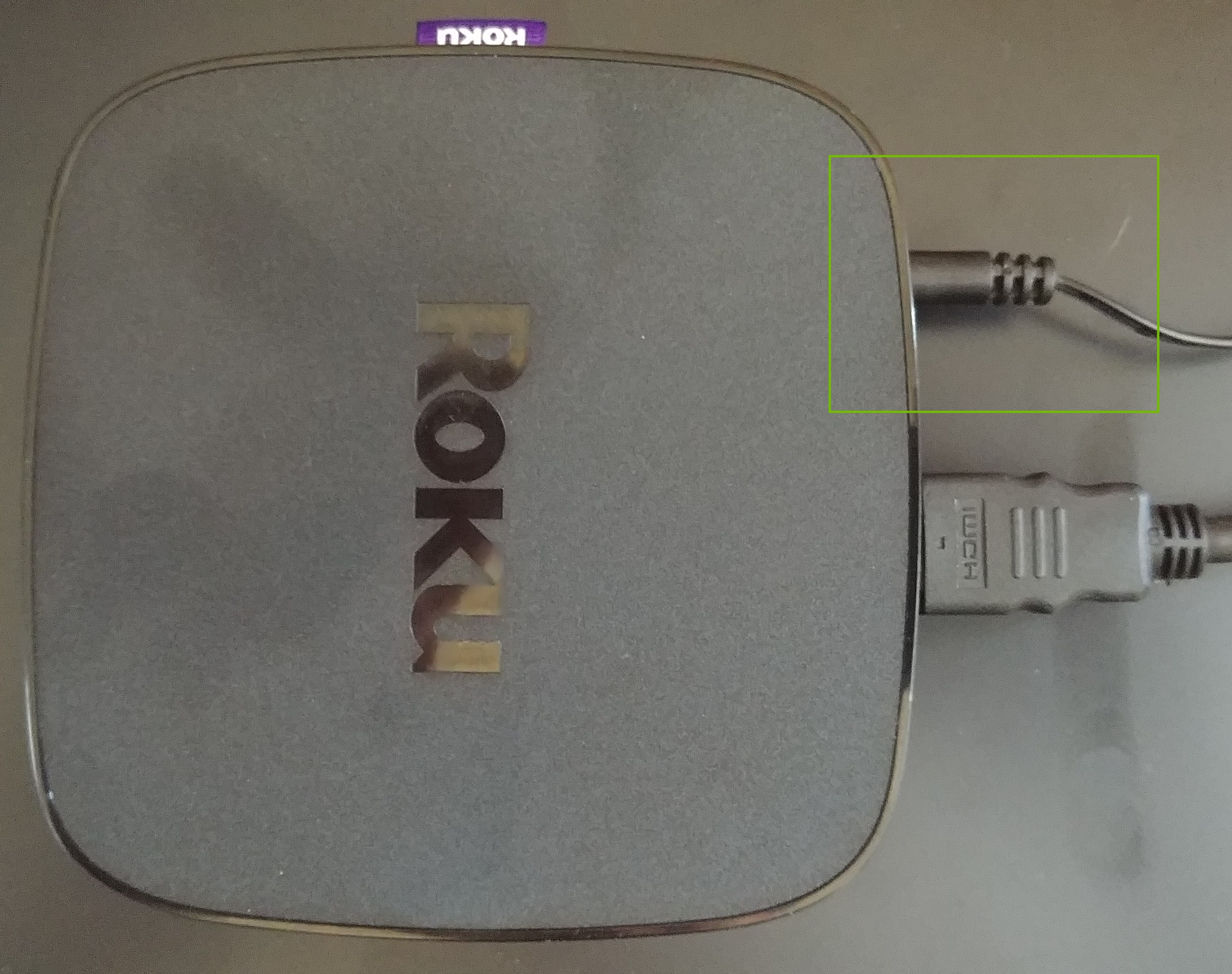 Roku with power cable plugged in.