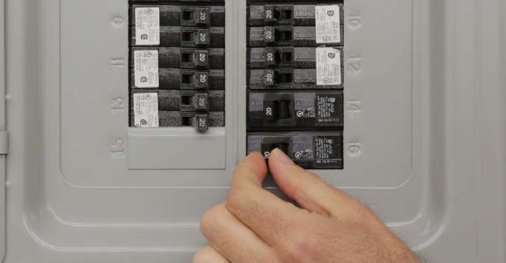 Circuit breaker box with breaker being switched off.