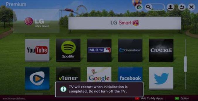 TV restart notification on screen.