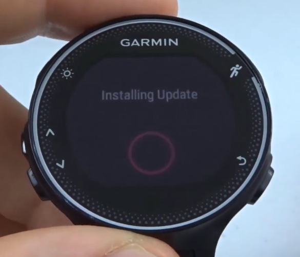Garmin Forerunner with update install progress on screen.