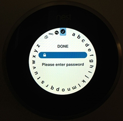 Nest thermostat prompting the user to enter the Wi-Fi network password.