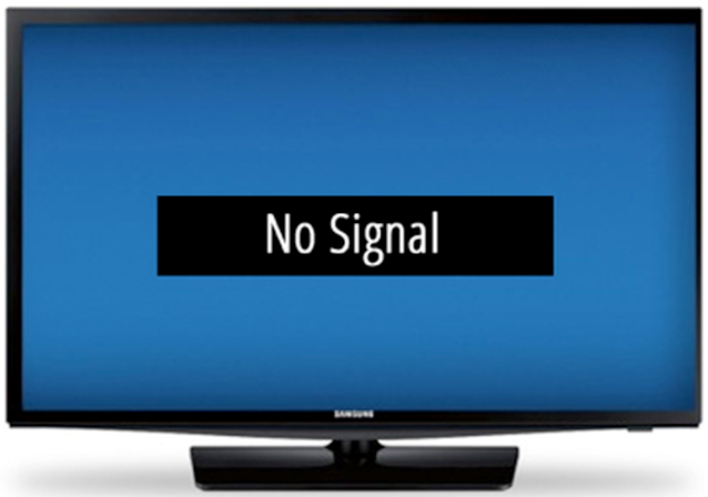 Television displaying a no signal message on-screen.