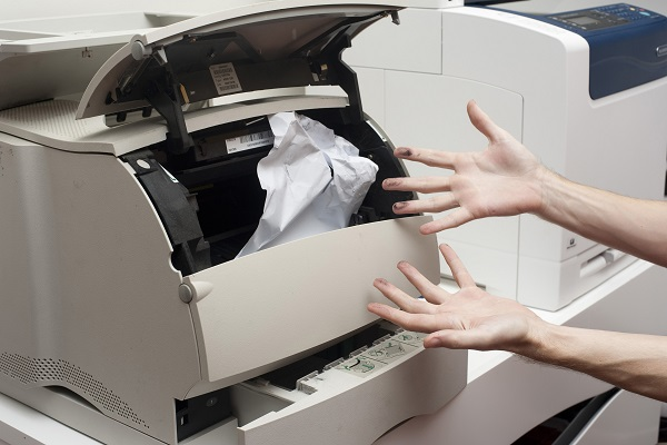 Stock photo of a printer with a paper jam.