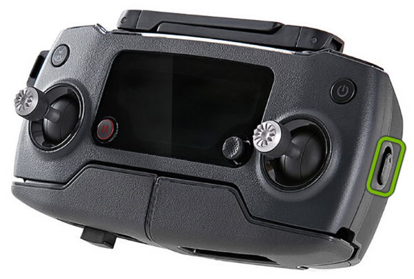 Flight mode switch highlighted on drone remote control.