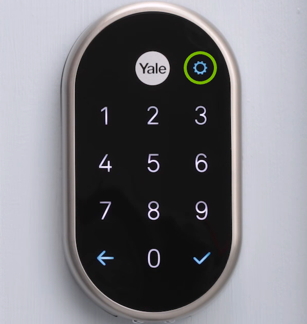 Gear wheel highlighted on lock keypad.