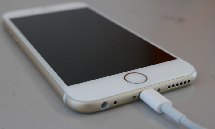 iPhone with lightning cable plugged in