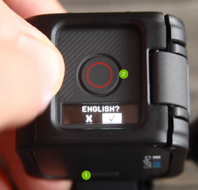 GoPro camera menu with English selected. Shutter button highlighed above and Menu button highlighted below.