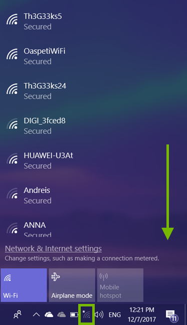 Wi-Fi icon highlighted in Windows 10 system tray and scroll direction annotated in Wi-Fi network list.