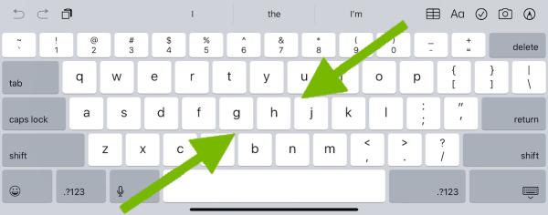 Arrows showing pinching motion on iPad on-screen keyboard.