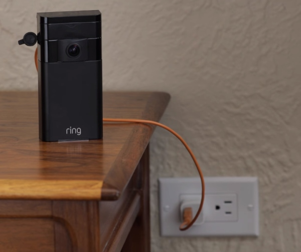 Ring Stick Up Cam plugged into power outlet.