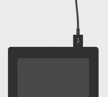 USB cable connected to tablet