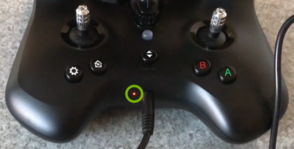 Battery charge indicator light highlighted in remote control.