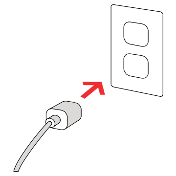 Speaker power cord being plugged into power outlet