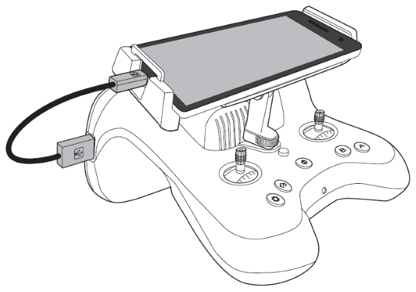 Mobile device connected to remote control with USB cable.