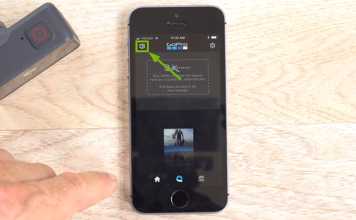 GoPro app with the camera icon highlighted in the upper-left corner of the smartphone screen.