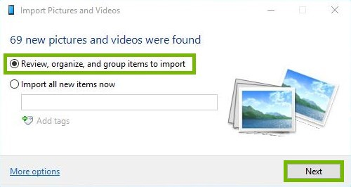 Import pictures and videos screen with Review, organize, and group items to import and the next button highlighted