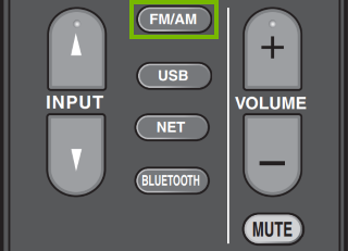 Radio input button highlighted on remote control.