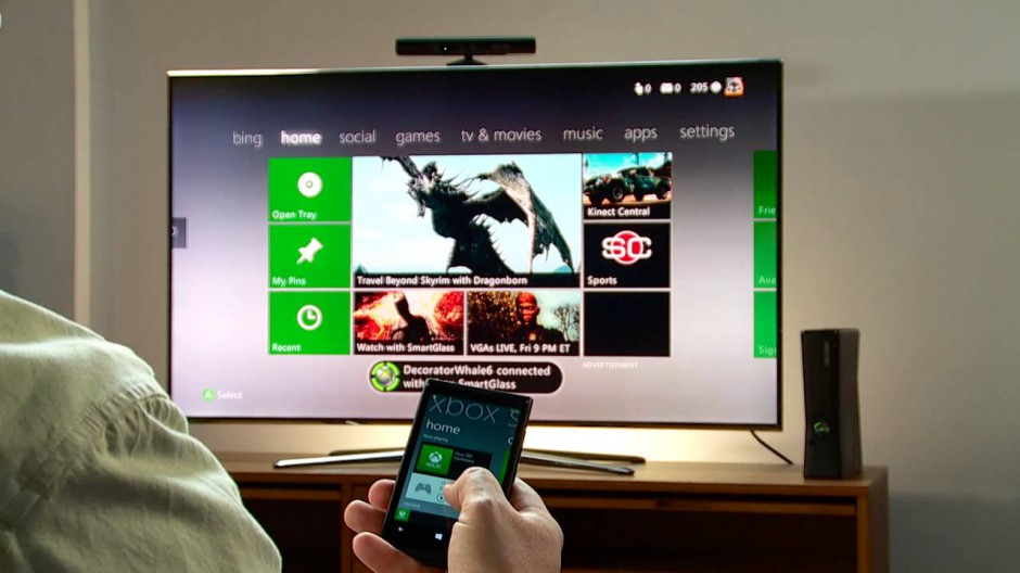 Smartphone controlling an Xbox 360 with the Smartglass app. Illustration.