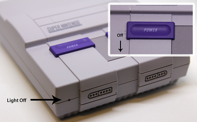 Picture of a Super Nintendo Classic Edition with the power switch in the off position, and the power LED off