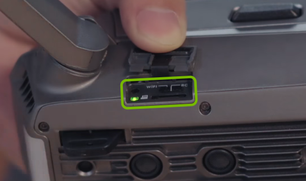 Control Mode switch highlighted on right side of drone.