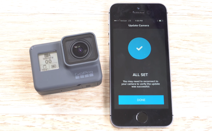 GoPro HERO6 having completed the update process, and a smartphone acknowledging the update was processed successfully.