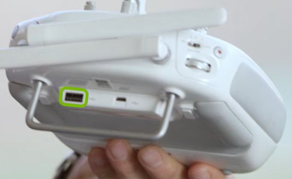 USB port highlighted on rear of remote control.