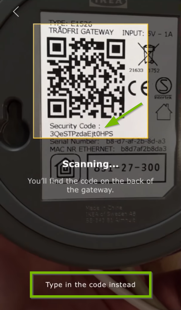 Security code pointed out on bottom of gateway and Type in code instead option highlighted in Ikea Tradfri app.