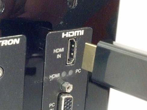 HDMI cable plugging into PS3 rear HDMI port.