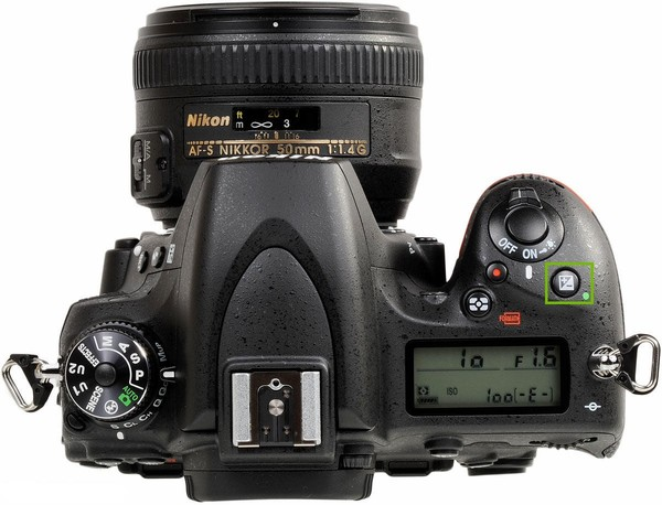 Top of camera with plus minus button highlighted.