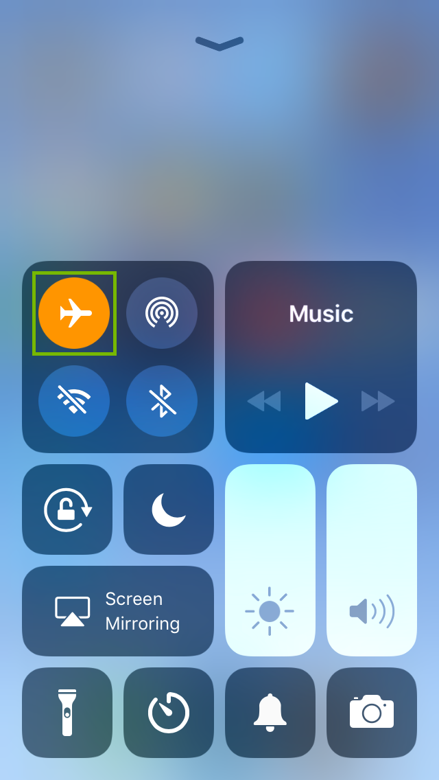 iPhone control center highlighting the airplane mode icon being engaged.
