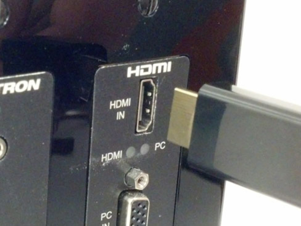 Back of TV showing HDMI Input with cable being plugged in