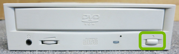 Eject button highlighted on disc drive.
