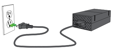 Xbox One power supply being plugged into wall outlet.