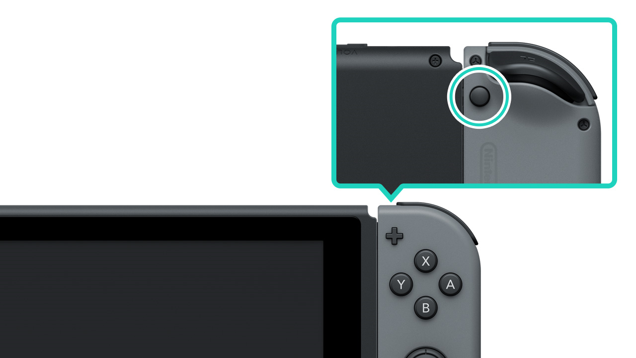 Back of Nintendo Switch console showing release button on Joycon