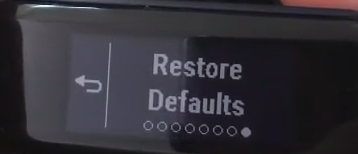 Garmin Vivosmart displaying the restore defaults option.