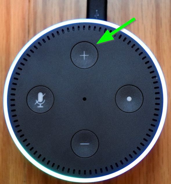 Amazon device with a green arrow pointing to the volume up button