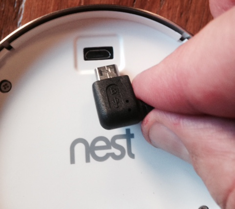 The back of a nest device showing the USB cable and slot
