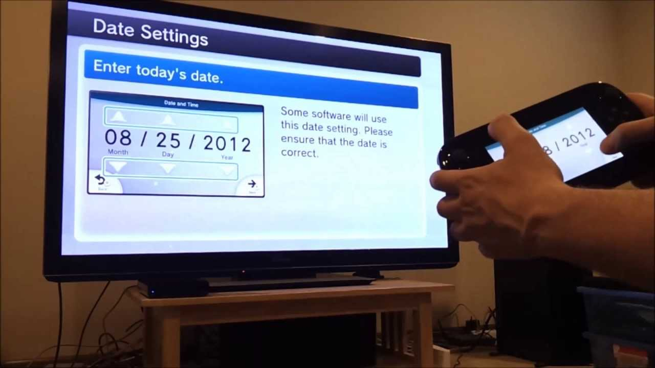 A television connected to a wii u showing the date settings