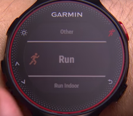 Garmin Forerunner with red runner button pressed