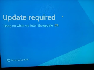 A chromecast image on a television showing that it is updating at 0 percent