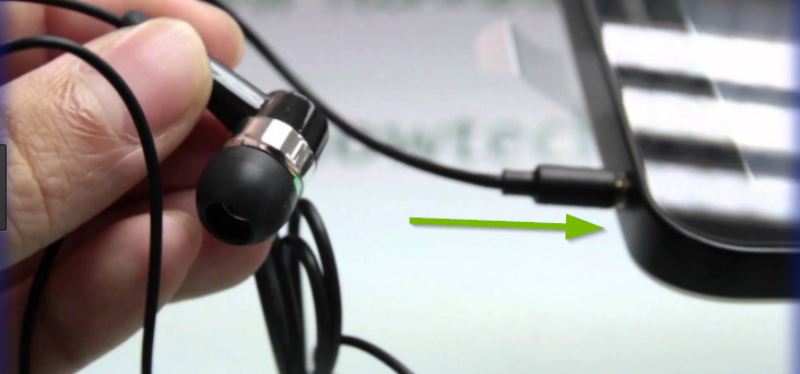 Earbuds with jack being shown connecting