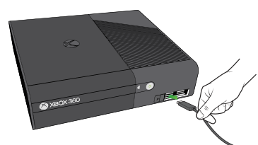 Xbox 360 console showing usb being plugged in